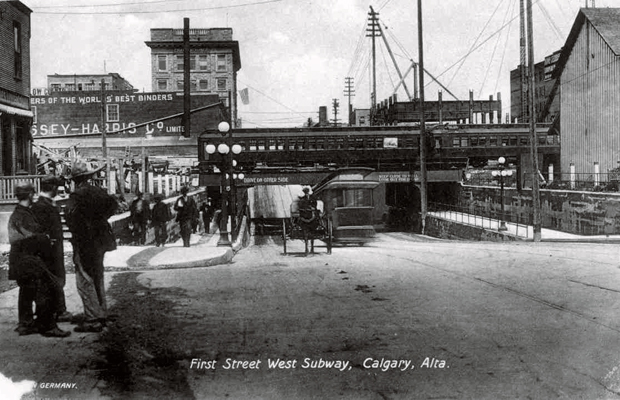 Note the Fairmont Palliser Hotel is under construction in this photo so this would be 1913. In some ways this underpass hasn't really changed very much.