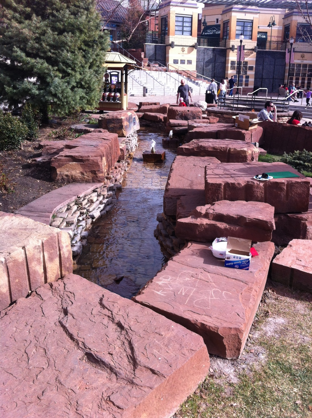 The plaza includes these red rocks and water feature inspired by the Utah landscape.