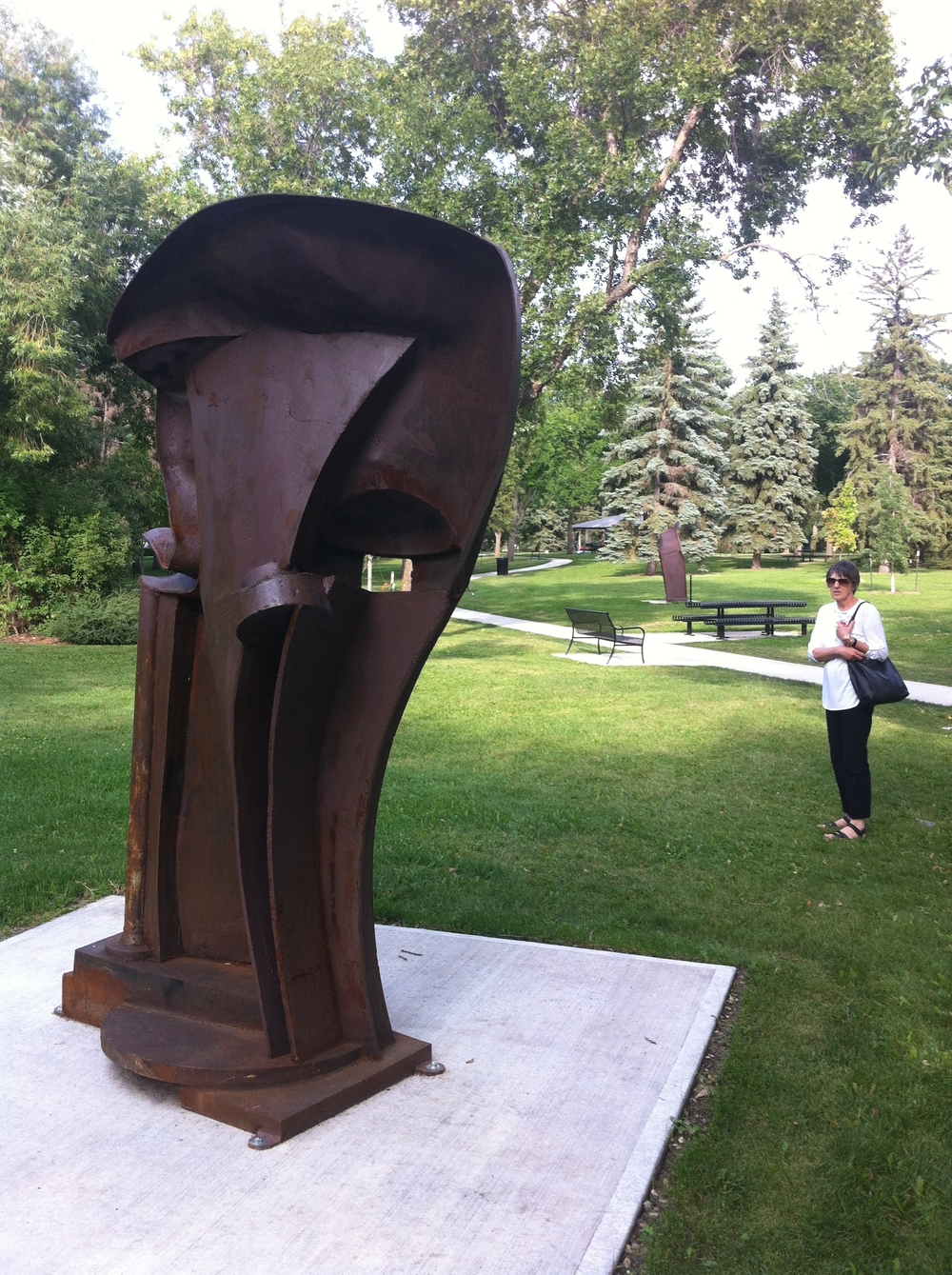 "Gaekwar of Baroda (1999) by Peter Hide, mild steel. Gaekwar of Baroda is particularly inspired by the Indian sandstone reliefs of the Bordon Collection housed at the Glenbow Museum in Calgary. Sculptor Peter Hide states, ""I was attracted by the voluptuous curves of the human body played off against the massiveness and rigidity of architectural forms. I wanted to try and bring some of these qualities into steel sculpture."