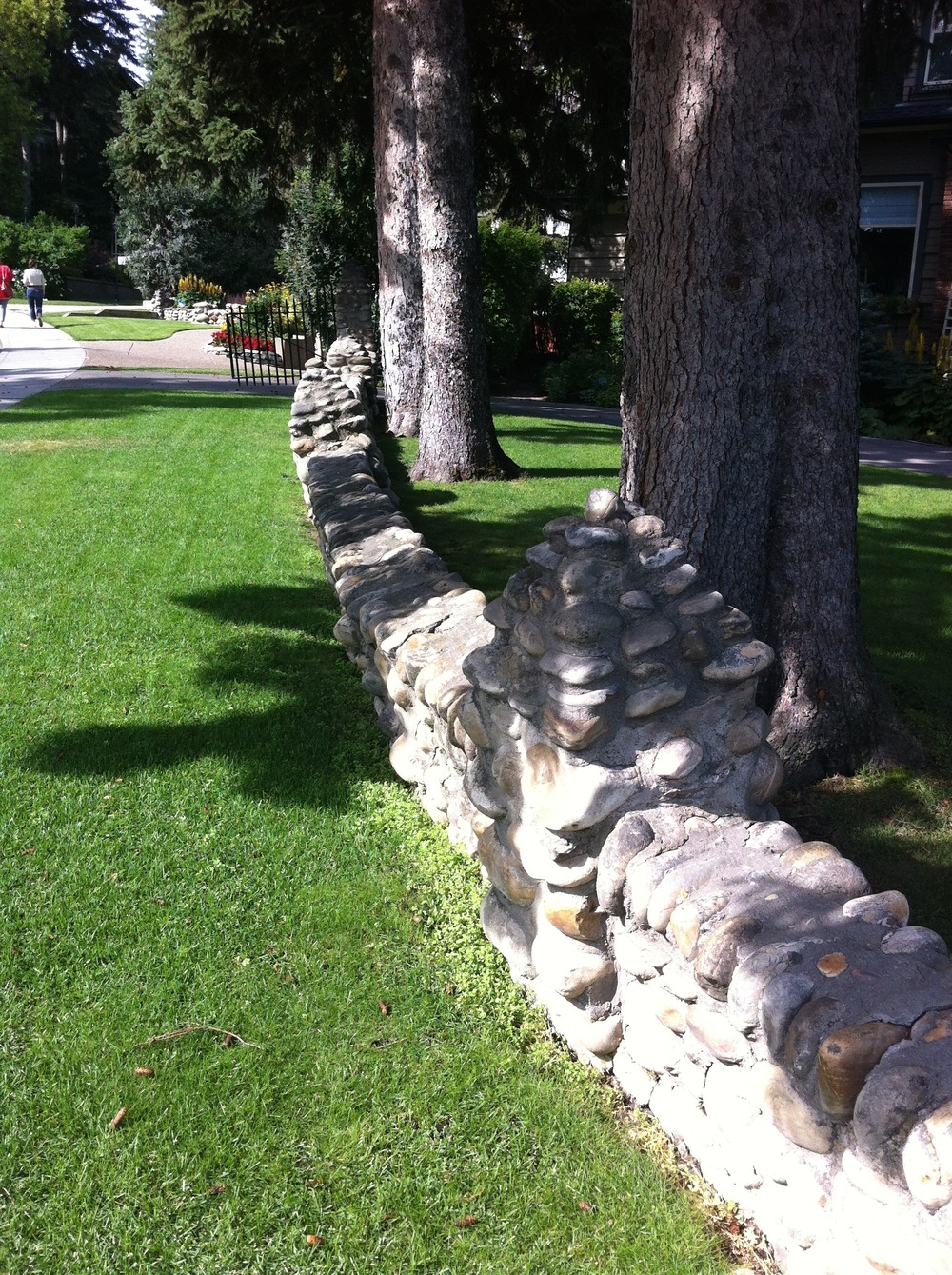 One of the many river rock walls from the early 20th Century that add charm to the community.