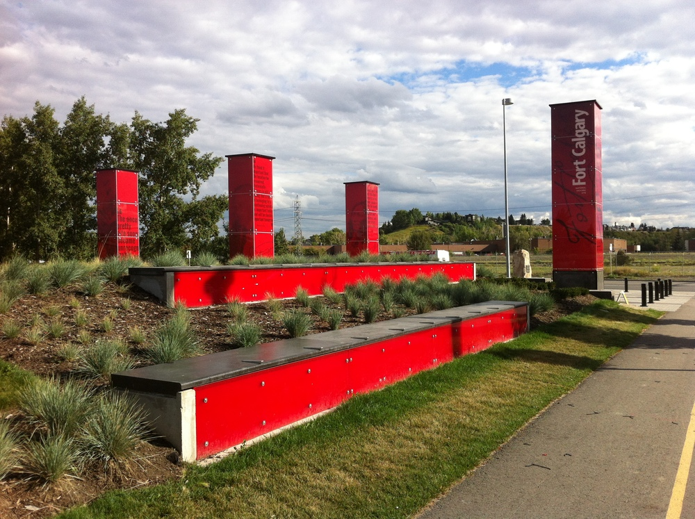 New entrance to Fort Calgary from the southwest with LED sentinels and benches.