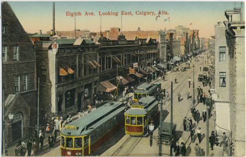 Early 20th century postcard of Stephen Avenue with street cars, vehicle and pedestrians sharing the space.