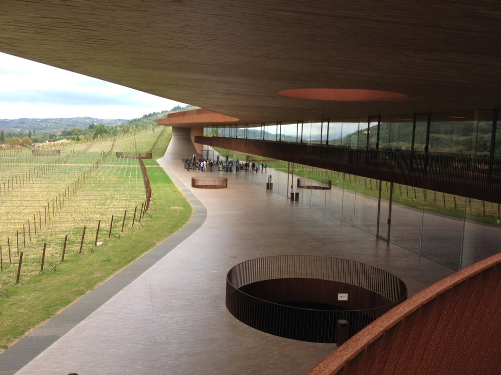 At ground level, you can see how the colour, pattern and rhythm of the vineyard is reflected in the building's shape and in the staircase. The dramatic circles of the skylights mimic the base of a wine bottle.