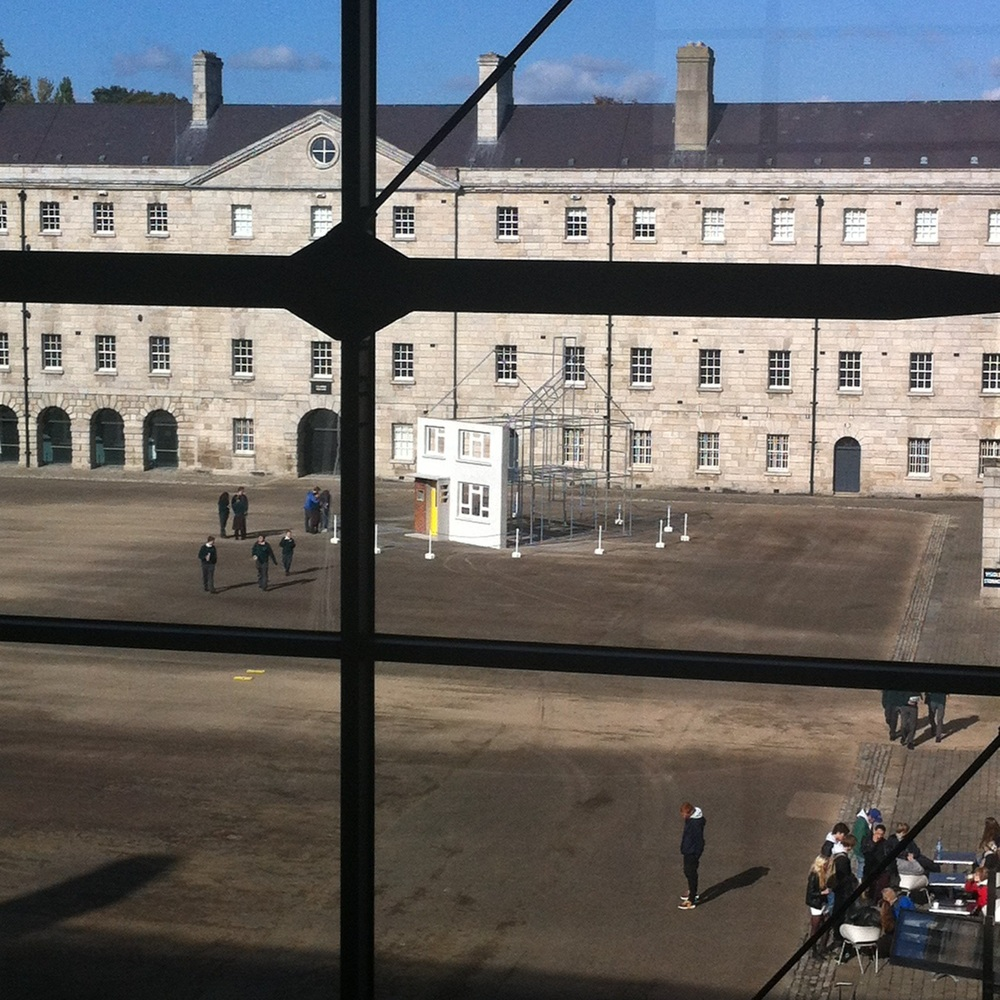 A view of the back of the house and the cafe spilling out onto the plaza gives some life to the parade square.