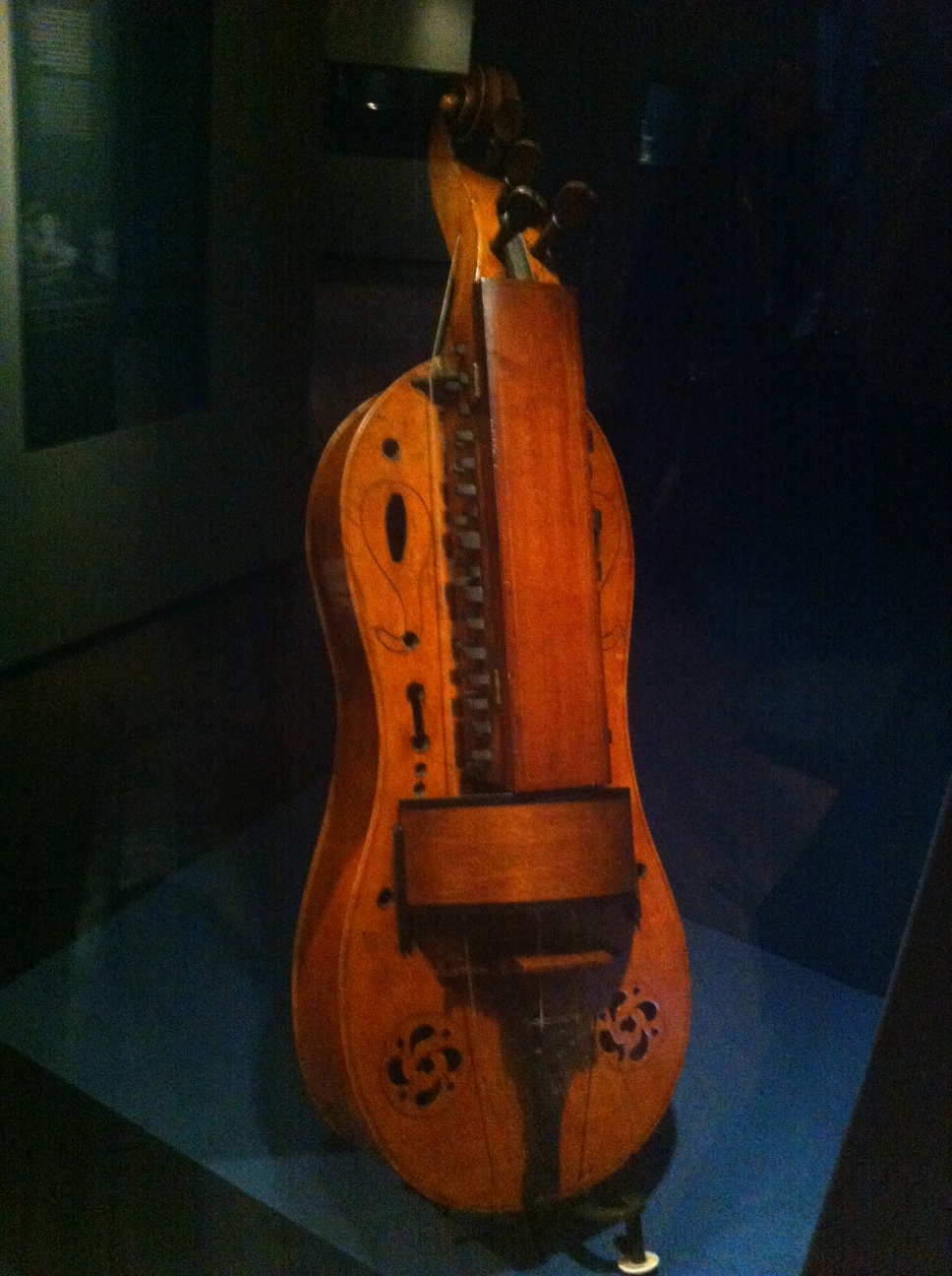 This hurdy-gurdy instrument is just one of the many exhibits of historical decorative arts and crafts in the museum.
