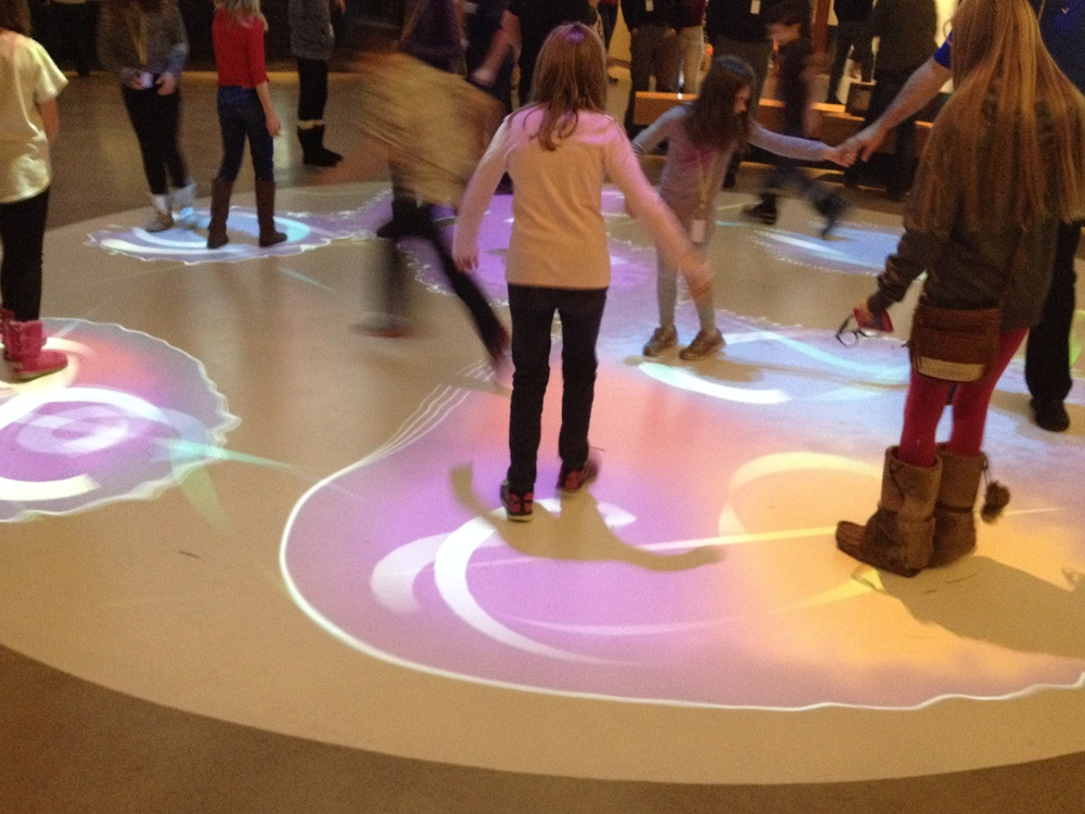 Children loved the interactive floor of colour. As each person stepped onto the floor they were surrounded by a ring of colour and as you moved closer to others your coloured rings joined.  If there are enough people, and you worked together you get the whole floor to light up.