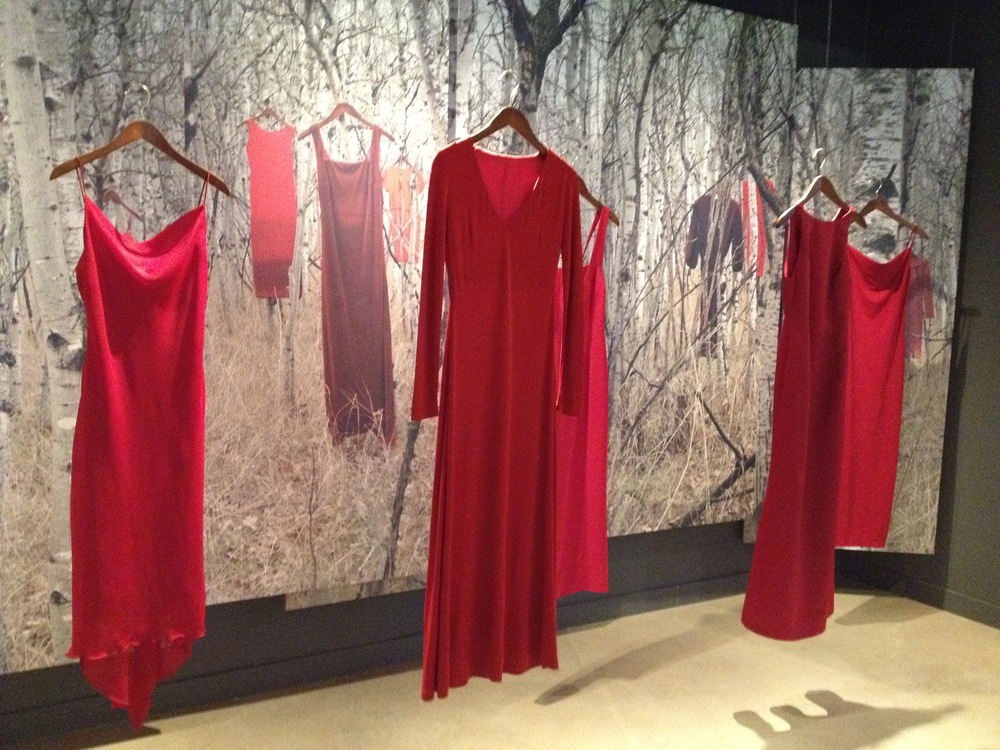 Jaime Black, The REDress Project, 2010 to present, empty dresses collected by community donation with digital backdrop. The REDress Project is an ongoing public art installation. It is a response to the overwhelming number of missing or murdered Aboriginal women across Canada. The installation seeks to engage the public in discussion about the sexist and racist nature of violent crimes against Indigenous women.