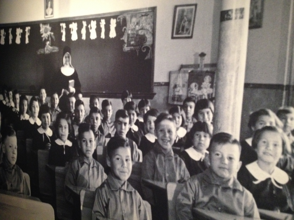 "Photo of residential school.  The information panel included the following quote: ""I want to get rid of the Indian problem...Our objective is to continue until there is not a single Indian in Canada that has not been absorbed into the body politic..."" Duncan Campbell Scott, Deputy Superintendent of Indian Affairs, 1913 to 1931."