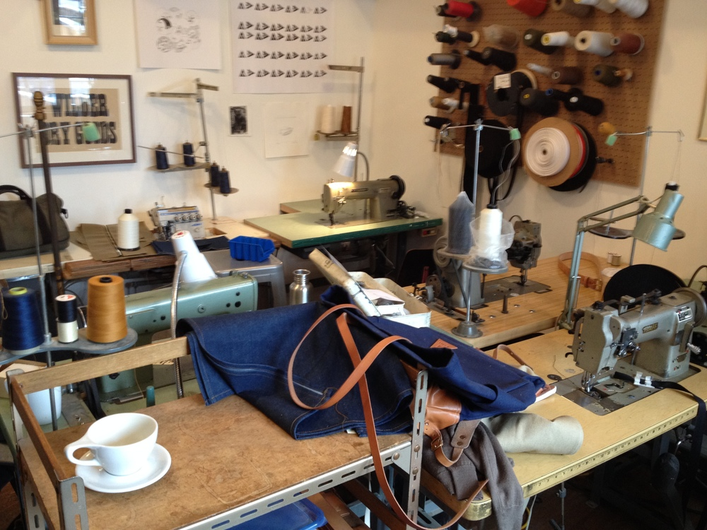 Wilder Goods workshop with one of the denim aprons.