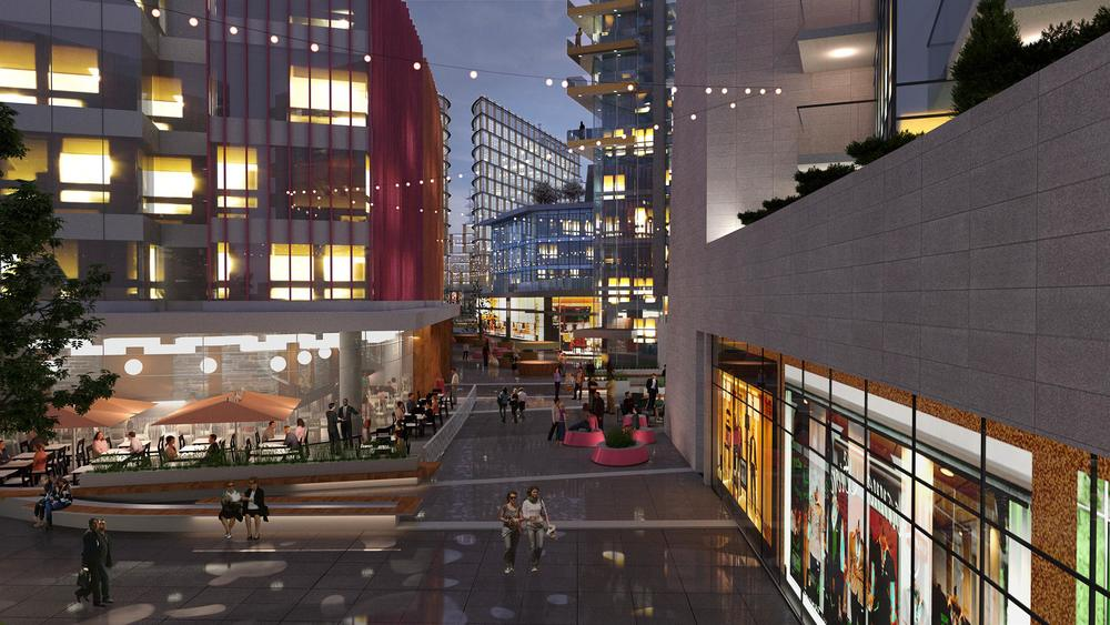 RK Visualization rendering of East Village pedestrian street at night with dinning and shopping activities. (photo credit: Calgary Municipal Land Corporation)