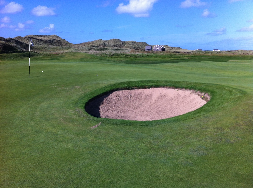 Who puts a bunker in the middle of a green? Bad idea!