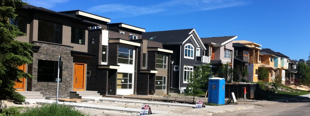 A parade of new infill home in Calgary's trendy West Hillhurst just 3 km from downtown.