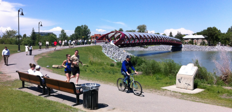 Peace Bridge links the north and south side of the extensive Bow River pathways system for walkers, joggers and cyclists. It is like an impromptu parade at noon hour in the summer, which creates a wonderful urban vitality.