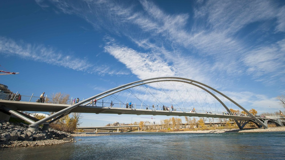 St. Patrick's Bridge has become a popular meeting place for walkers, joggers and cyclists.  It has some similarities to the Bow Trail Bridge with its Chinook Arch shape and great views of the dramatic downtown skyline and the prairie sky. The bridge has an elegance that seems to frame the river, skyline and sky without being overbearing. (Photograph by Mark Eleven Photography, extended in courtesy of CMCL.)