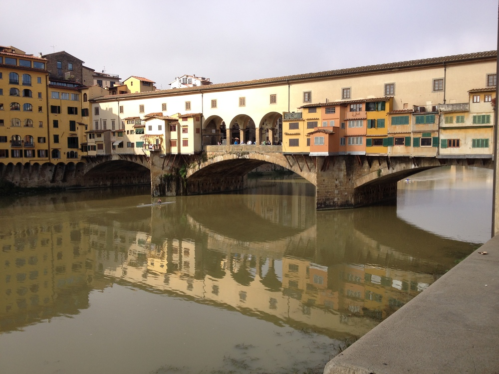 Ponte Vecchio from a little further back with reflection in Arno River.