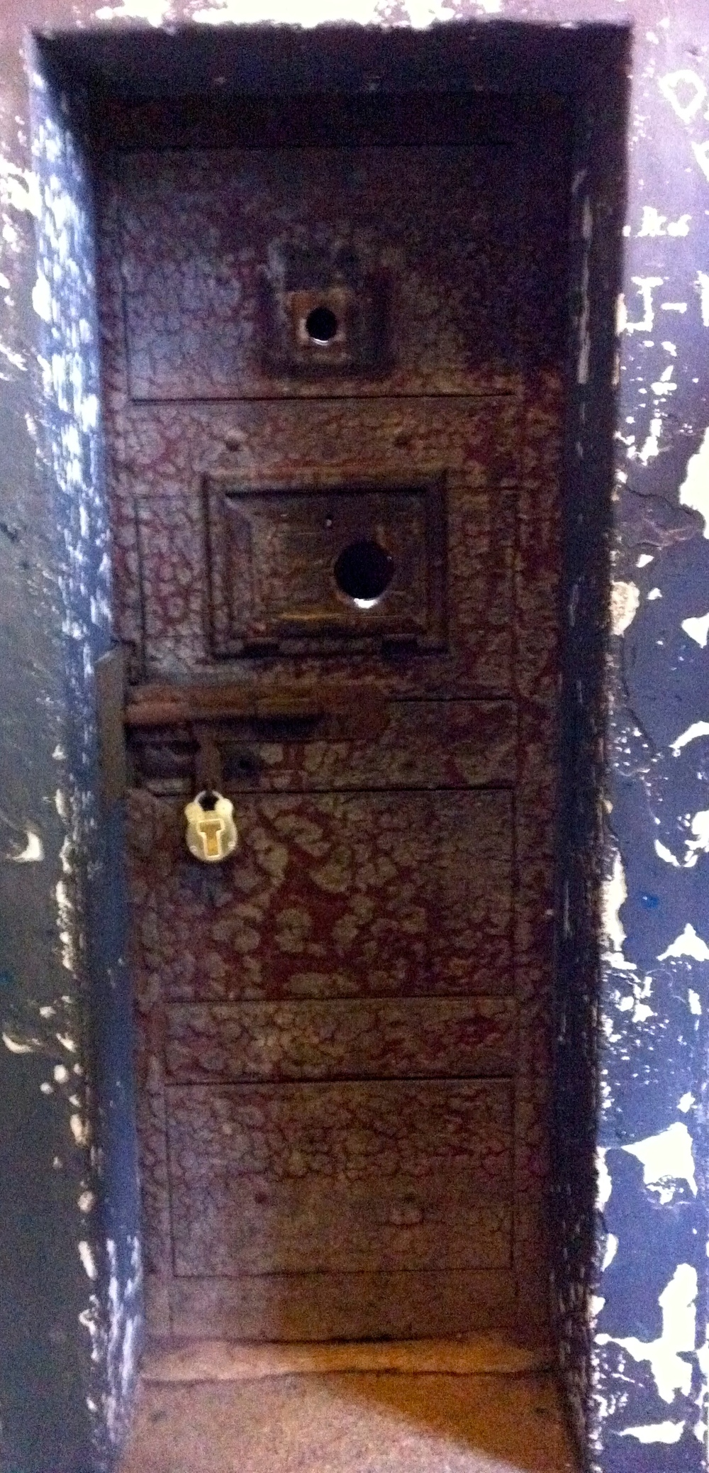 The gaol doors have centuries of grime encrusted on them to create a rich patina.