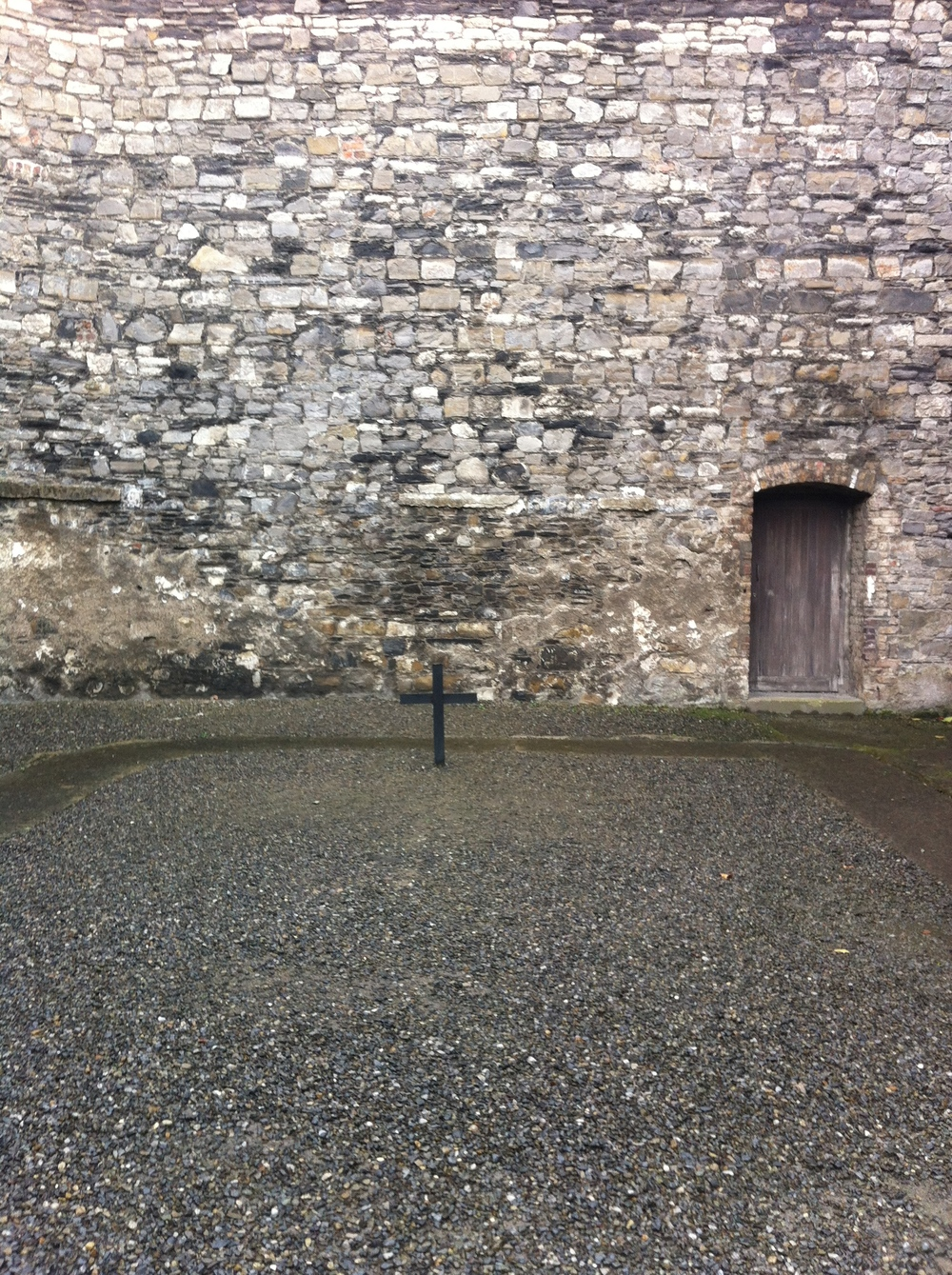 The cross marks the spot where the prisoners stood in the stone breakers yard waiting to be executed by gun fire.