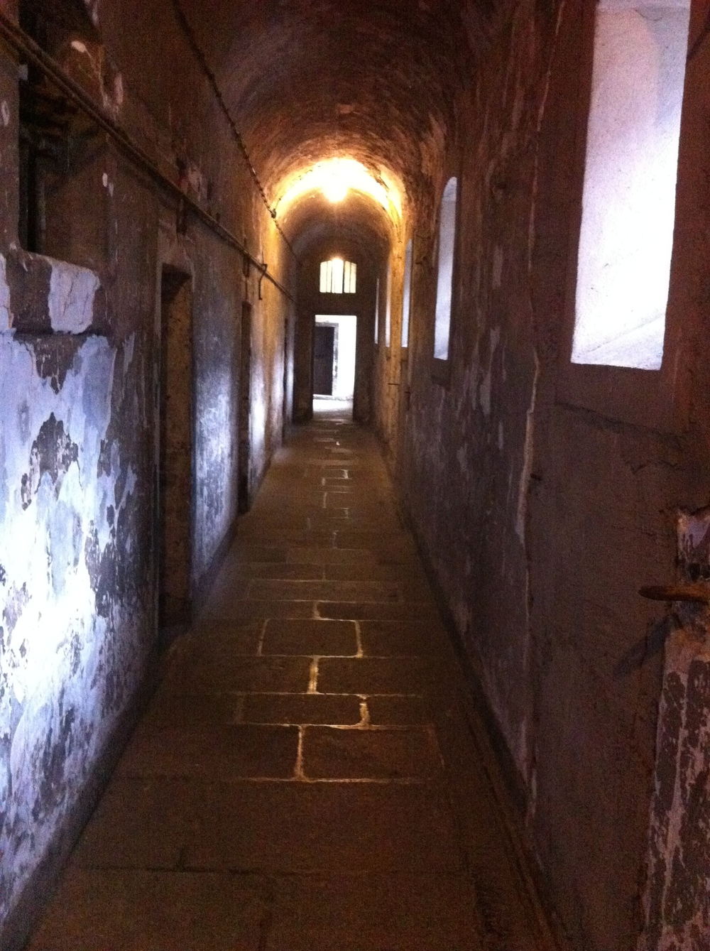 The hallways have a strange haunting glow that magnifies the decaying walls.