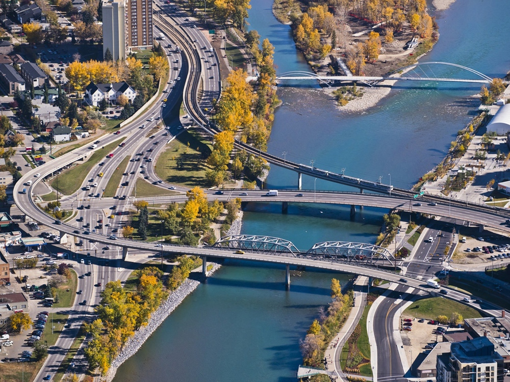 Five bridges cross the beautiful Bow River at the northeast entrance to downtown. (photo credit: Peak Aerials)