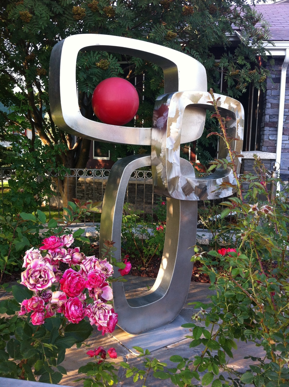 Fun sculpture in yard in Crescent Heights.