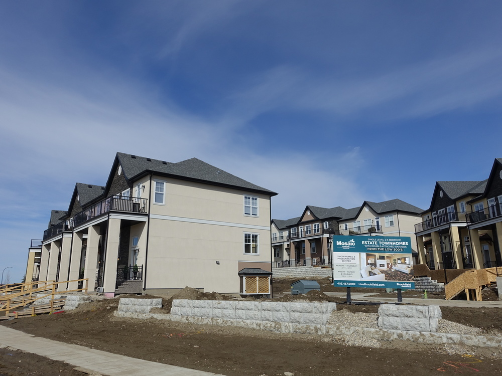 Attached townhomes are common in the new suburbs even in estate communities. These are not the suburbs of the '80s.