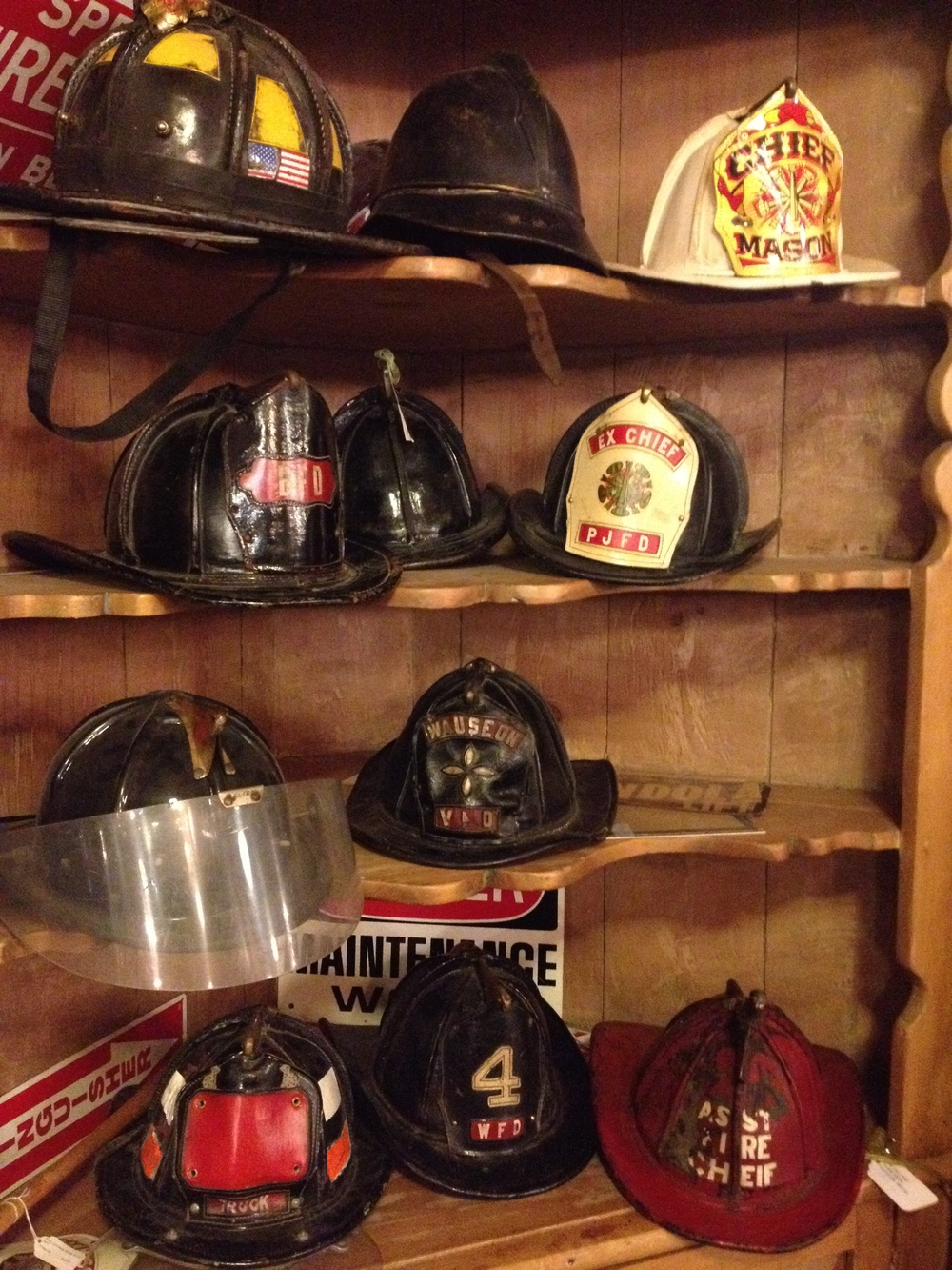A collection of Fireman Helmets waiting for the right collector.