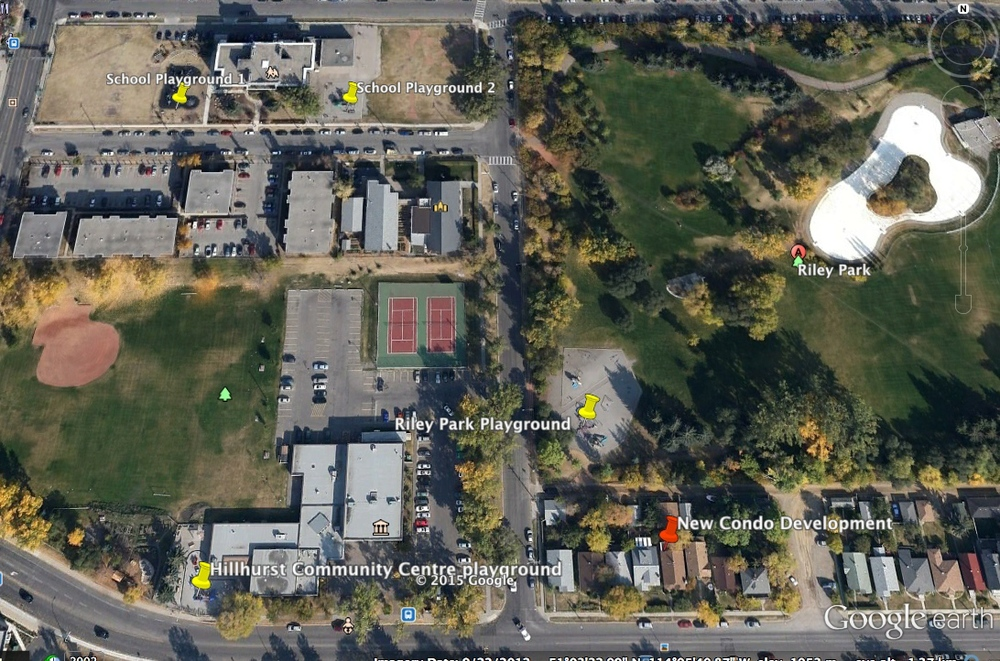 The yellow pins indicate the location of the four playgrounds. The white shape in the upper right corner is the wading pool in Riley Park.Theorangepin is in the middle of the block where a major condo complex is currently under construction.