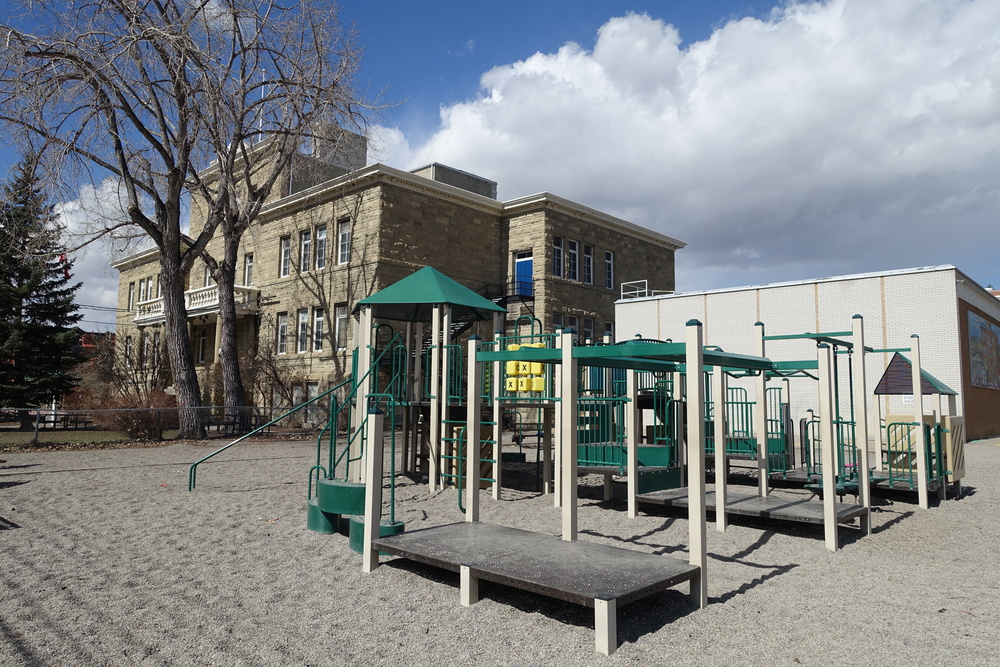 Playground on the east side of the historic sandstone Hillhurst School.