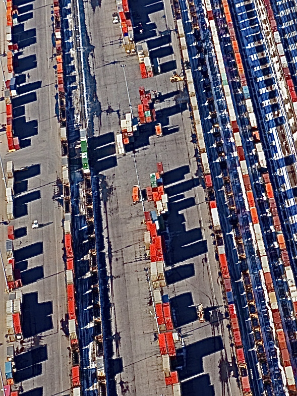 One of many distribution centres in Calgary with trucks loading and unloading goods to be truck to destinations across western Canada. (photo credit: Peak Aerials)
