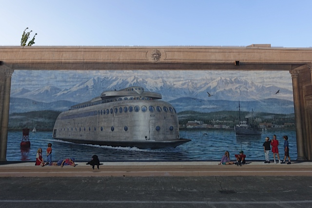 Mac's Mural is dedicated to H. Mac Ruddell, past president of the NorWester Rotary Club of Port Angeles, for his vision, energy and enthusiasm, which made the NorWester Rotary Mural project a reality. This mural is of the art deco Black Ball Ferry from Port Angeles to Victoria.