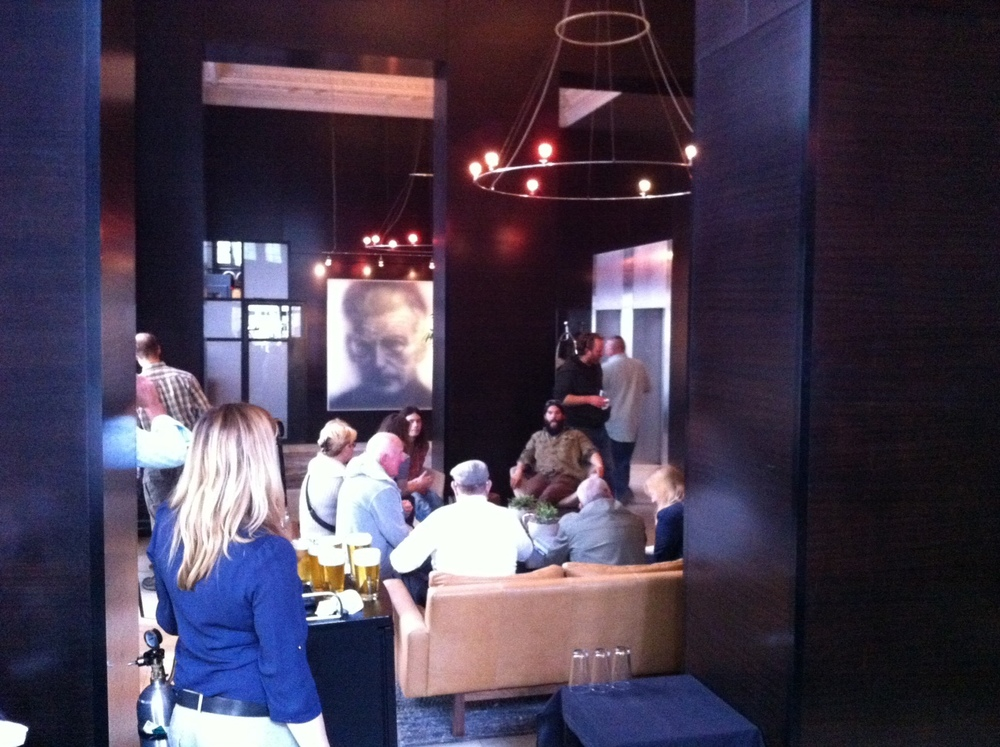 Happy Hour in the lobby of the Hotel Max with Samuel Beckett looking on.