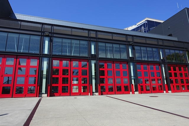 This is the new downtown fire station. Love the synergy of modern and traditional aesthetics.  Good architecture links the past with the present and creates as sense of place.  Love the red doors!