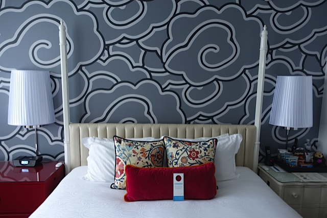 We called this our cloud bed - Hotel Monaco.The entire suite was full of bright, playful art and design. We called it our happy place!
