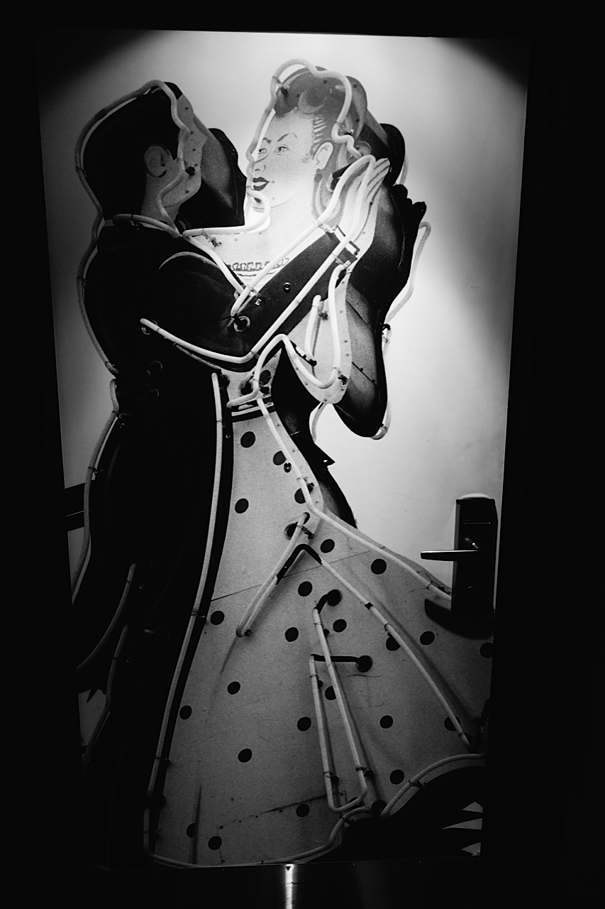 John Armstrong, Dancing Neon Couple, photograph, 10th floor