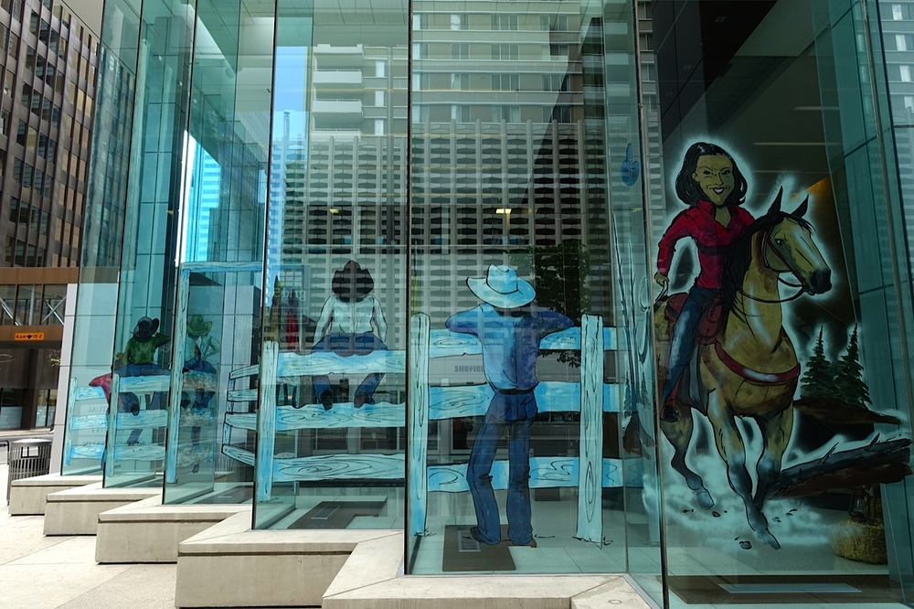 Office lobby reflections create attractive Stampede streetscape.