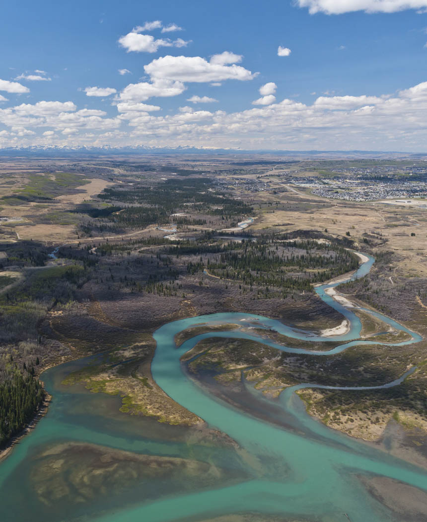 Weaselhead Flats and the Glenmore Reservoir serve as a natural dividing line between the inner city and established communities to the south.