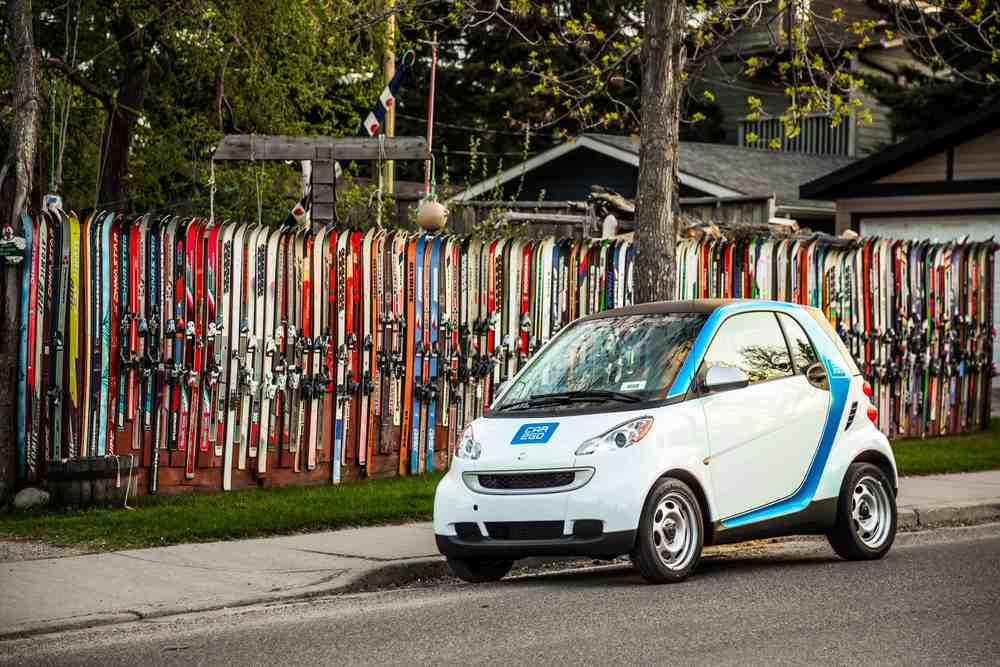 Car2go beside the colourful ski fence in Altadore.