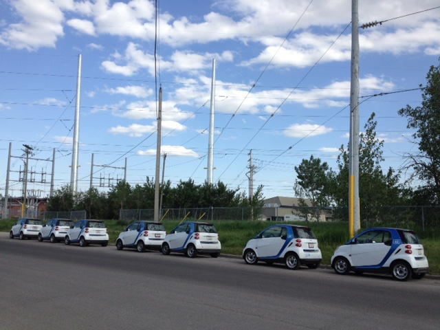 Line up of car2go on 50th Ave SW near River Park.
