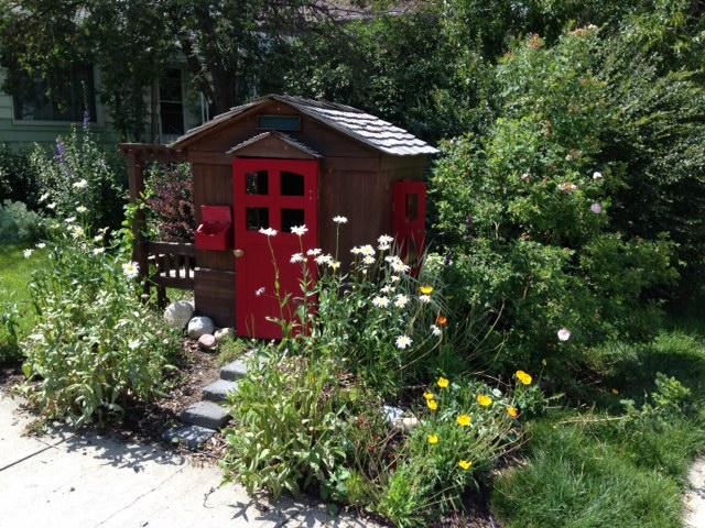 How cool is this play house in the front garden? It has a children's story book quality about it.
