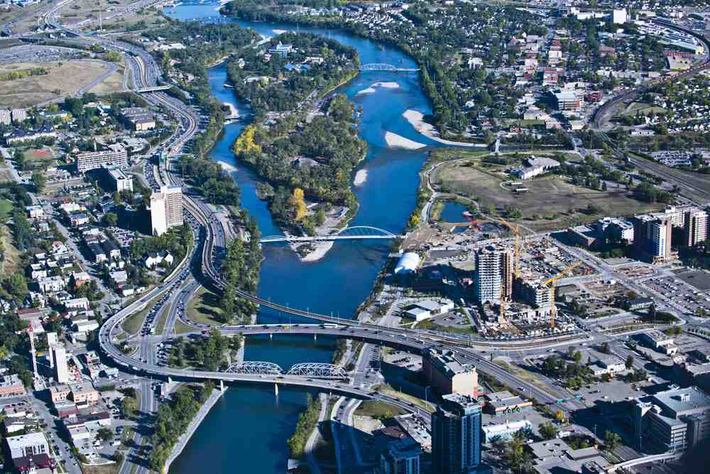 Aerial view of St. Patrick's and St. George's Islands along the Bow River (photo credit: Peak Aerials)