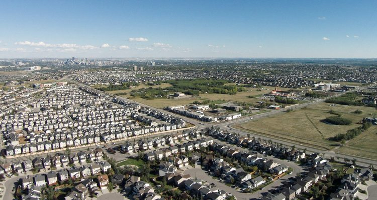 Aerial view of West District surrounded by sea of low density single-family homes i.e. 20th century new community planing