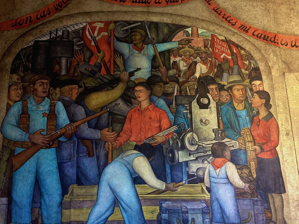 "A segment of one of Diego Rivera's murals titled ""In the Arsenal.""  Both the National Palace and the Secretaria de Educacion Publica are filled with Rivera murals that tell the stories of violence and passion of the Mexican people (both have free admission).  At the end of our visit my mom commented, ""Did you notice that most of his murals have a gun and military in them."""