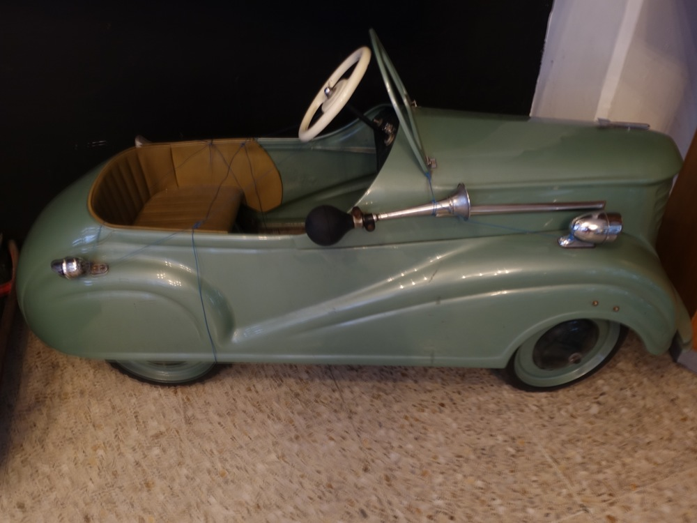 I had a peddle car as a kid but not a cool as this one.