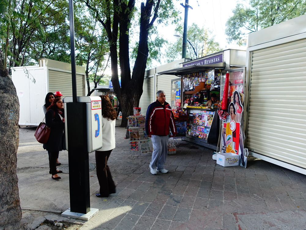 Upscale vendor sheds on the sidewalk in front of one of Mexico City's newest office towers.