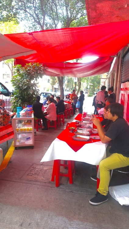 Sidewalk dining on a side street in Mexico City.