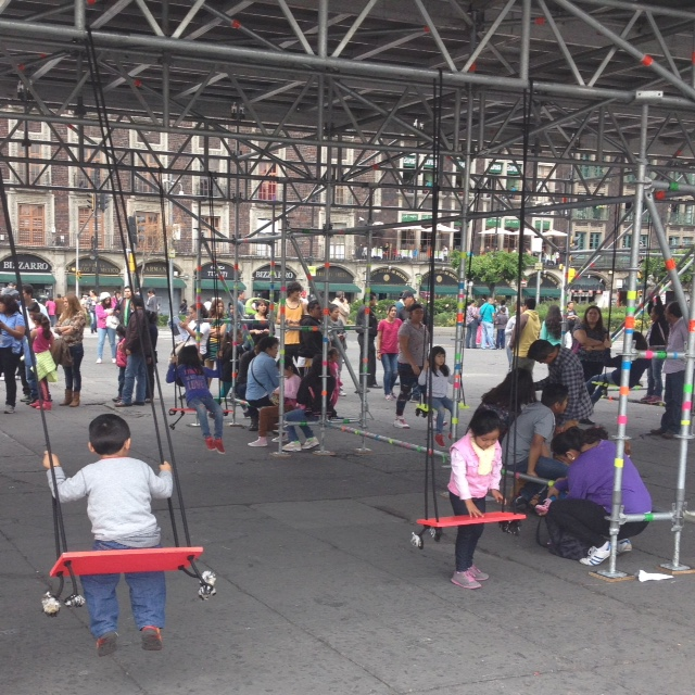 Found these children using temporary swings under bleachers set up for the World Archery Competition in Mexico City.