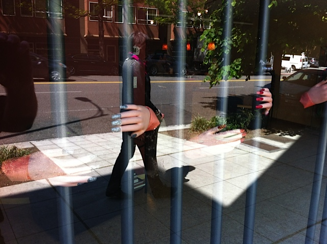 Loved the surrealism of this jail-like image created in a pedicure shop window in Seattle's tony Belltown.
