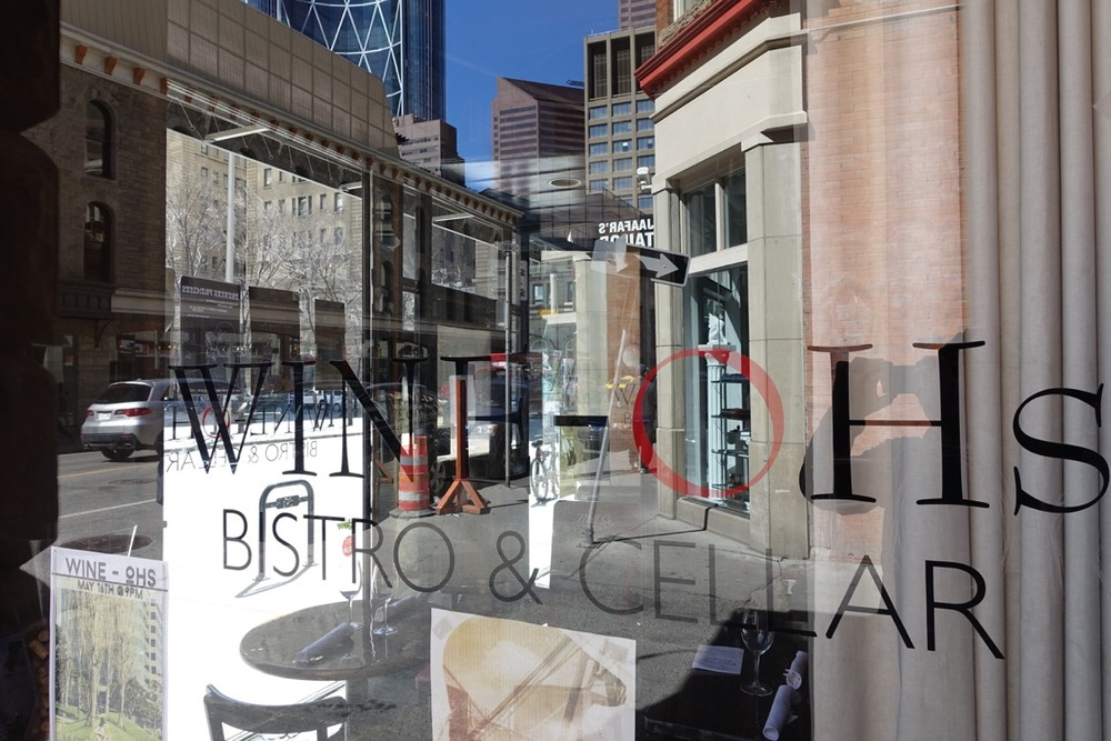 This window reflection is a visually stunning collage of architecture and facades in a downtown Calgary window.