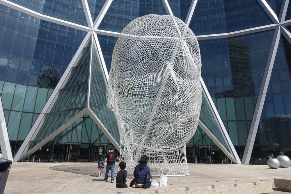 """""""Wonderland"""", 39 foot sculpture by Jaume Plensa, (plaza in front of The Bow office tower, downtown Calgary)"""