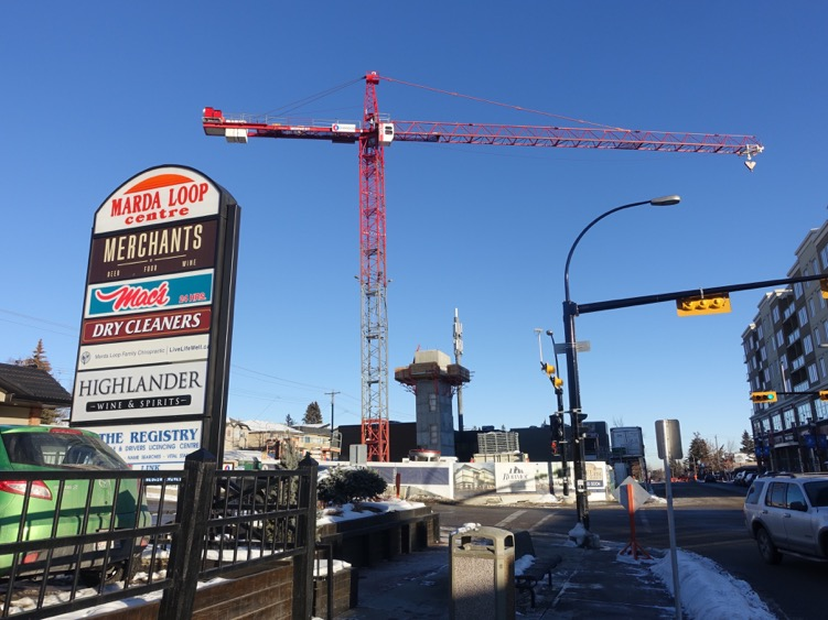 Construction cranes building Odeon, Marda Loop.